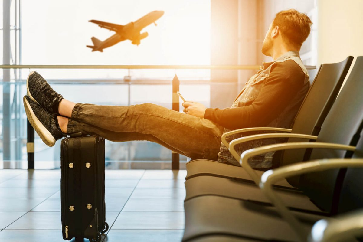 Man sitting on an airport
