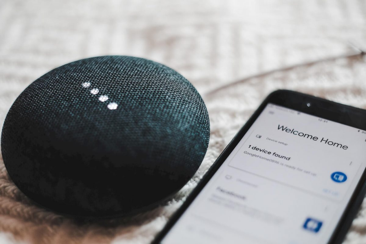 Google Home next to an Android phone