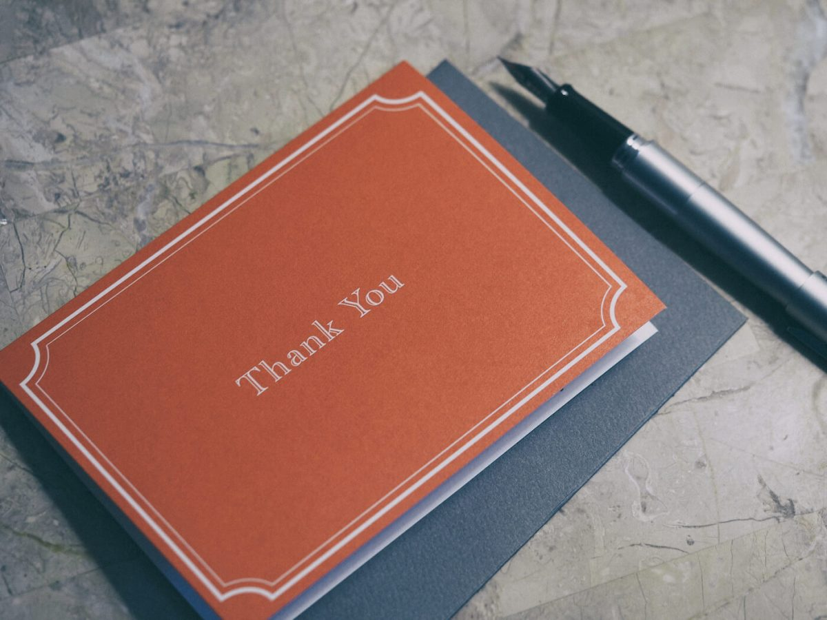 Thank you card on a table next to a fountain pen